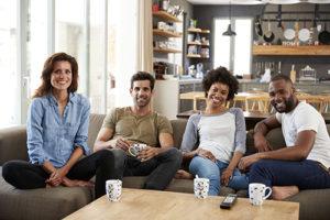 group having coffee in community housing program